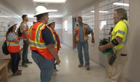 Teachers speak with construction staff during the 2018 Teacher Externship